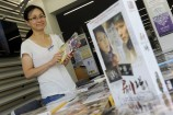 Librarian Emily Lee  checks out the DVDs at the Community Purchasing Afternoon. 150040 Picture: STEWART CHAMBERS